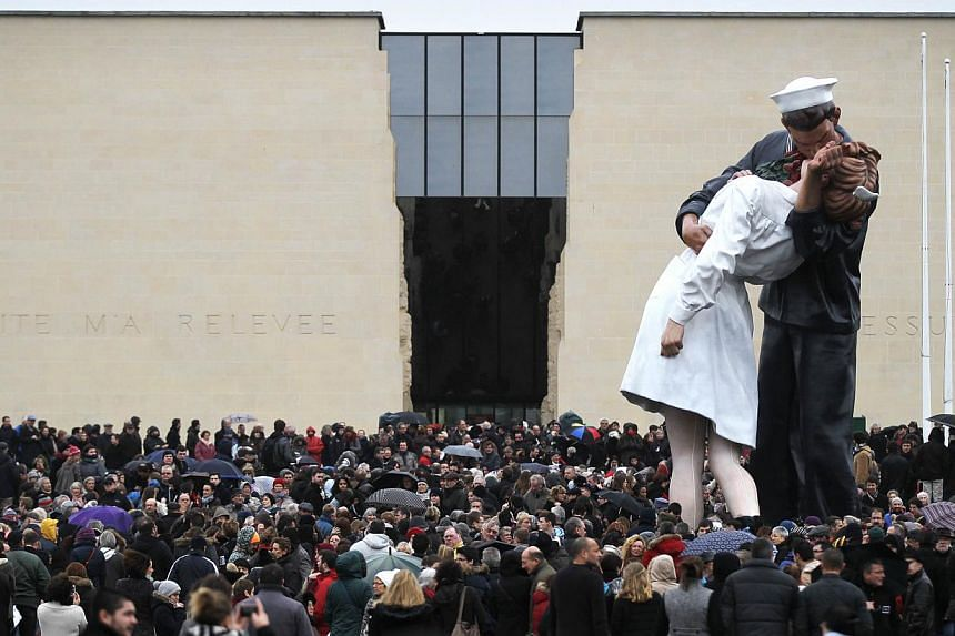 People rally at the Memorial Square in Caen on Jan 10, 2015, as tens of thousands of people staged rallies across France authorities said, after three days of terror and twin siege dramas that claimed 17 lives in total, including the victims of the f