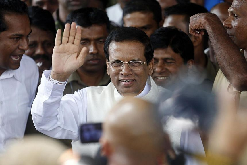 Sri Lanka's newly elected president Mithripala Sirisena waves at media as he leaves election commission in Colombo on Jan 9, 2015. -- PHOTO: REUTERS