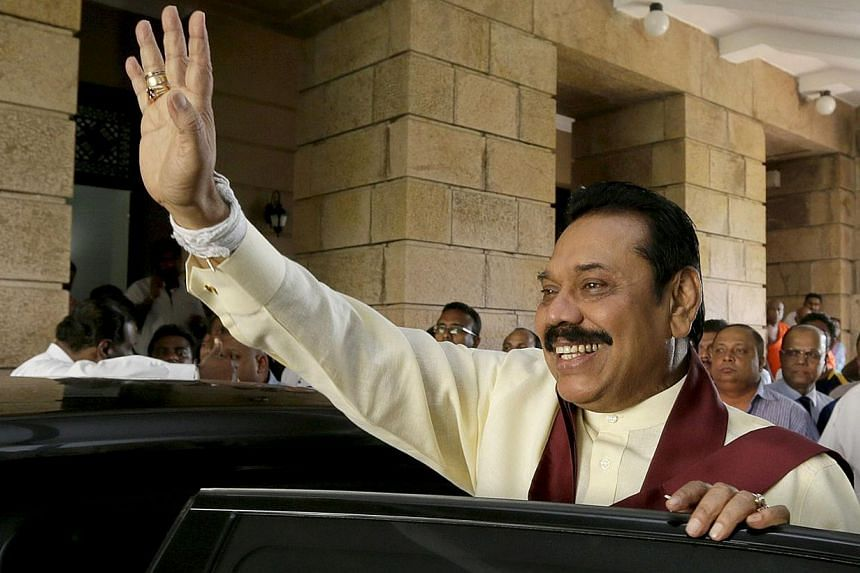 Outgoing Sri Lankan president Mahinda Rajapakse waves as he leaves his office in the capital Colombo on Jan 9, 2015. -- PHOTO: AFP