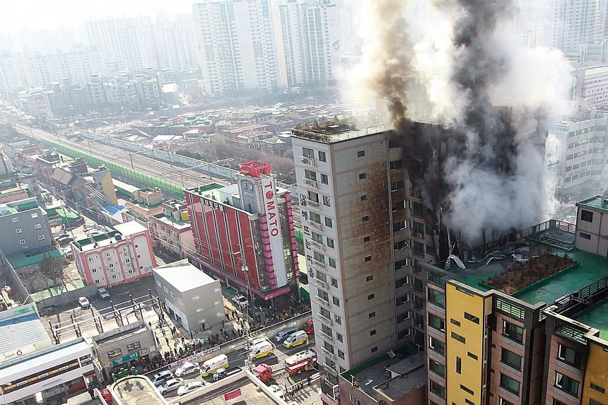 Three people were killed and more than 100 injured in a fire that swept through an apartment building north of Seoul on Saturday, firefighters said. -- PHOTO: EPA