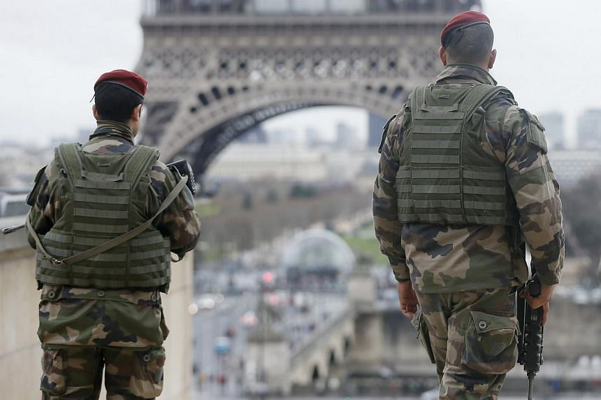 """French soldier patrols near the Eiffel Tower in Paris as part of the highest level of """"Vigipirate"""" security plan after a shooting at the Paris offices of Charlie Hebdo Jan 9, 2015. -- PHOTO: REUTERS"""