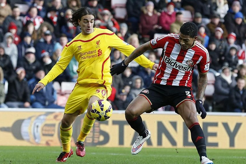 Liverpool's Lazar Markovic (left) scores the opening goal during the English Premier League soccer match between against Sunderland AFC and Liverpool FC at the Stadium of Light in Sunderland, Britain, on Jan 10, 2015. -- PHOTO: EPA