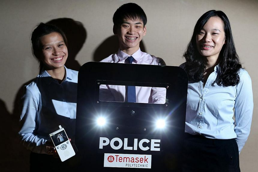 Engineering students (from left) Florence Quek, Ng Jun Hong and Low Siyi with their prototype anti-riot shield. It features strobe lights to blind rioters and a camera that can wirelessly relay footage.