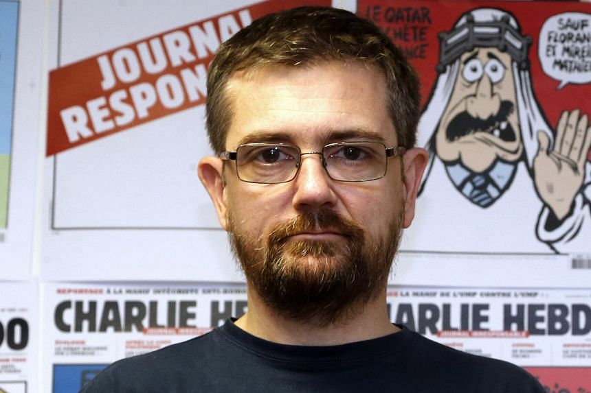A file photo taken on Dec 27, 2012 in Paris shows Charlie Hebdo's murdered editor Stephane Charbonnier - nicknamed Charb -in the newspaper's offices. -- PHOTO: AFP