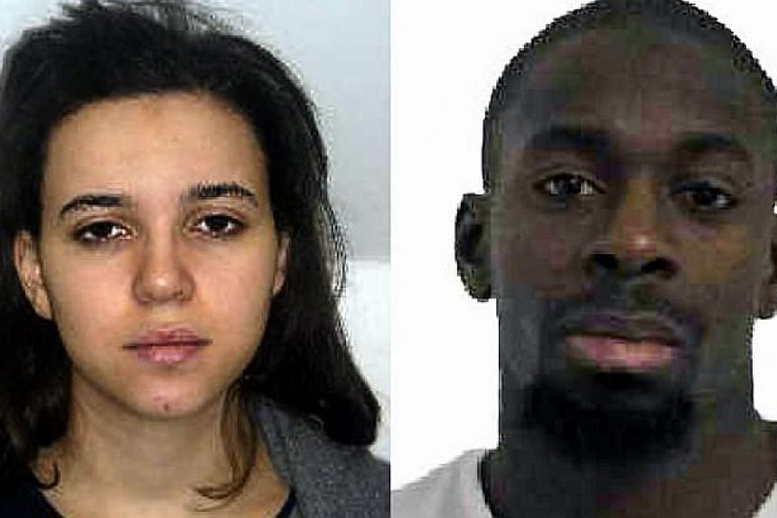 The gunman who was shot dead by Paris police after taking hostages at a Jewish supermarket on Friday (above right) phoned other people from the scene, urging them to stage further attacks, a security source said. His wife (left) is still being sought