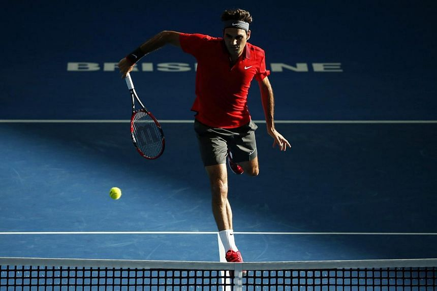 Roger Federer of Switzerland plays a shot at the net during his men's singles semi final win over Grigor Dimitrov of Bulgaria at the Brisbane International tennis tournament in Brisbane, on Jan 10, 2015. -- PHOTO: REUTERS