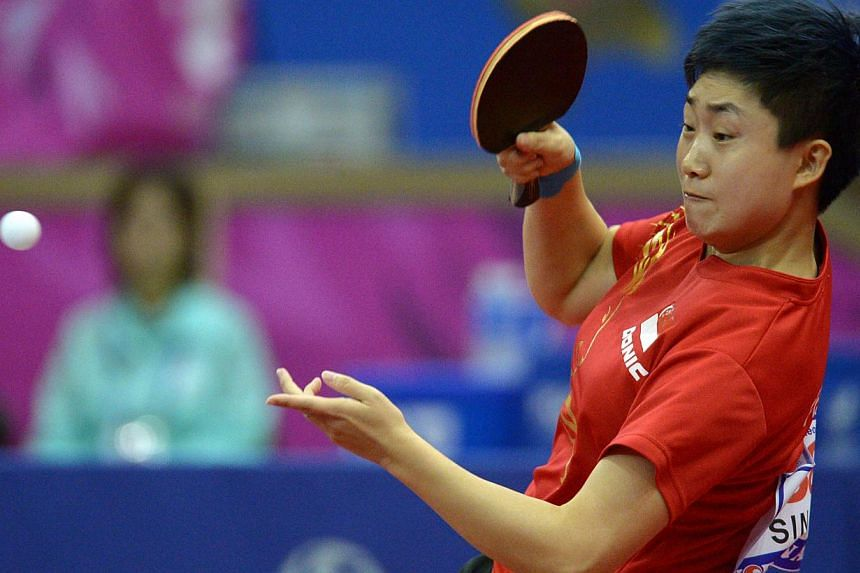 Singapore's Feng Tianwei in action against China's Zhu Yuling in the table tennis women's semi finals during the 2014 Asian Games at the Suwon Gymnasium in Incheon on Oct 4, 2014. -- PHOTO:DESMOND WEE