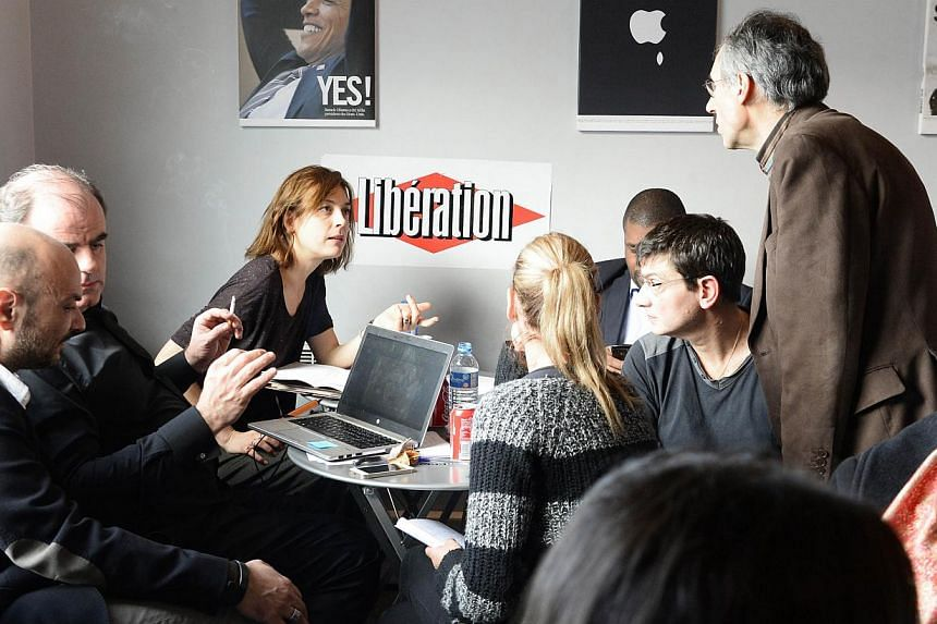 The office at the headquarters of Liberation on Jan 9, 2015 in Paris, as editorial staff of French satirical newspaper Charlie Hebdo and Liberation gather. -- PHOTO: AFP
