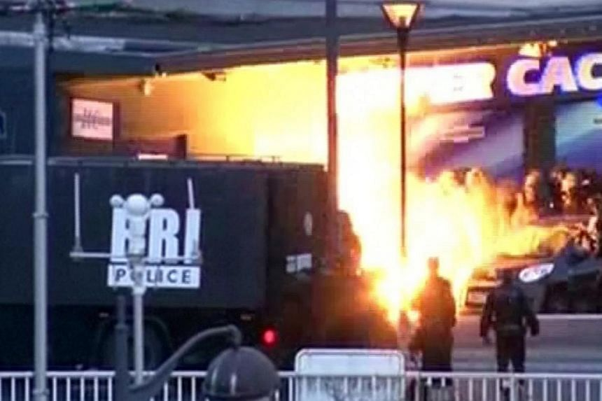 A still image from video shows an explosion lighting the front of a kosher supermarket as French police special forces launch their assault, where several people were taken hostage near the Porte de Vincennes in eastern Paris Jan 9, 2015. -- PHOTO: R