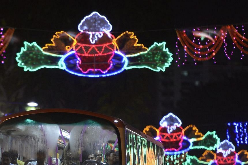A man on a double decker bus observes the light up along Serangoon Road as part of the annual Pongal Festival Celebrations (Harvest Festival) at Little India on Jan 10, 2015. -- ST PHOTO:MARK CHEONG