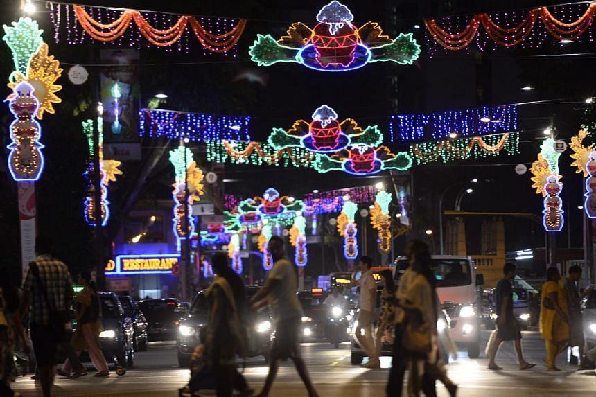 People walk across the light up at Serangoon Road as part of the annual Pongal Festival Celebrations (Harvest Festival) at Little India on Jan 10, 2015. -- ST PHOTO: MARK CHEONG