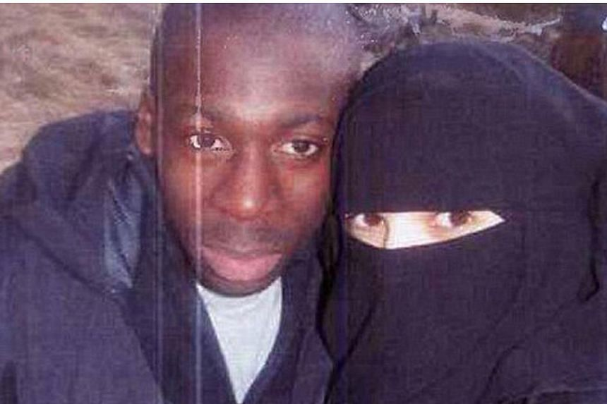 Hayat Boumeddiene with Amedy Coulibaly in Cantal, France, in 2010. She claimed they had crossbow training. -- PHOTO: MAILONLINE