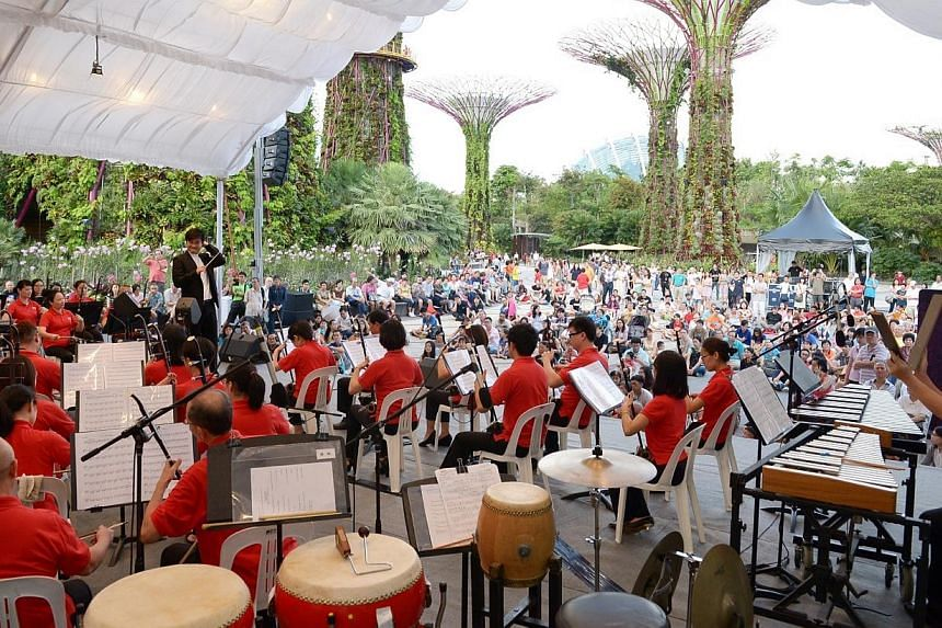 The Singapore Chinese Orchestra (SCO) performing at Gardens by the Bay on Saturday, Jan 10, 2015. -- ST PHOTO: DESMOND WEE