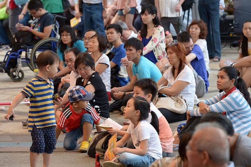 Audience watching Singapore Chinese Orchestra's (SCO) performance at Gardens by the Bay on Saturday, Jan 10, 2015. -- ST PHOTO: DESMOND WEE