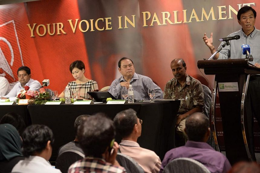 Singapore Democratic Party (SDP) secretary-general Chee Soon Juan (right) speaks during the SDP GE2015 Campaign Kick-off while party member Bryan Lim (from left), party member James Gomez, assistant treasurer Jaslyn Go, vice chairman John Tan and par