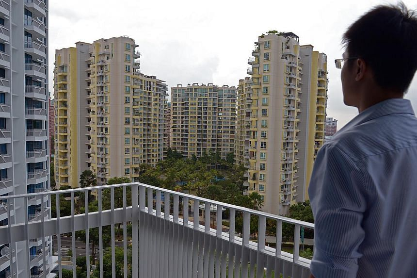 A man looking at a condominium at Paisir Ris Drive 1. A spate of data on the Singapore economy's performance in December, from SRX Property's flash figures for condominium resale prices to private housing rentals, is set to be released this week. --