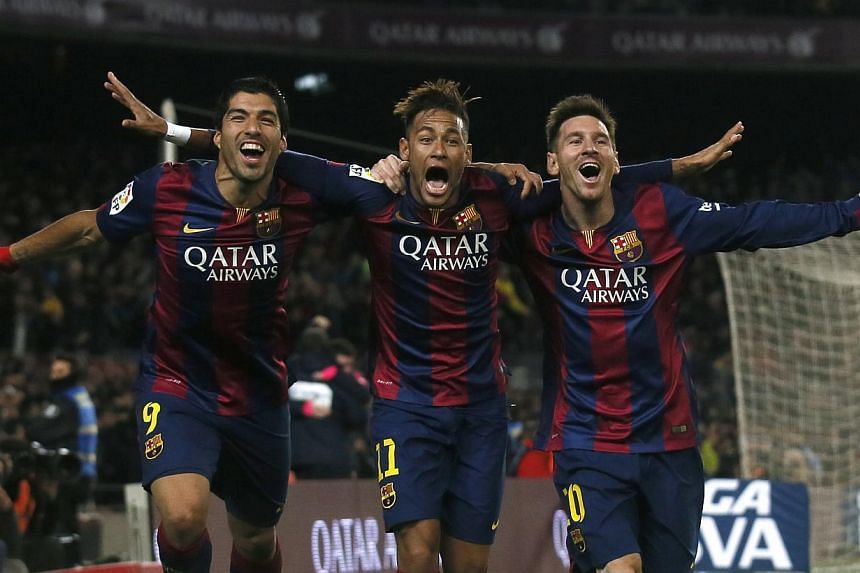 (From left) Luis Suarez bagged his second La Liga goal, Neymar opened the scoring for Barcelona, while Lionel Messi hit the third to calm the Catalans' nerves after Atletico threatened to make a comeback. -- PHOTO: REUTERS