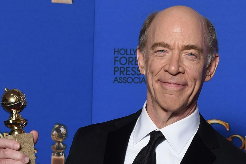 J.K. Simmons won the first award handed out at the Golden Globes on Sunday, the best supporting film actor prize for his turn as a brutal music teacher in Whiplash. -- PHOTO: AFP