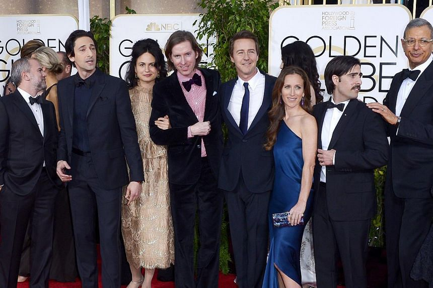 Adrien Brody (second from left), The Grand Budapest director Wes Anderson (centre), Edward Norton, Jason Schwartzman (second from right) and Jeff Goldblum (R) arriving for the 72nd Annual Golden Globe Awards on Jan 11, 2015. Wes Anderson's The Grand