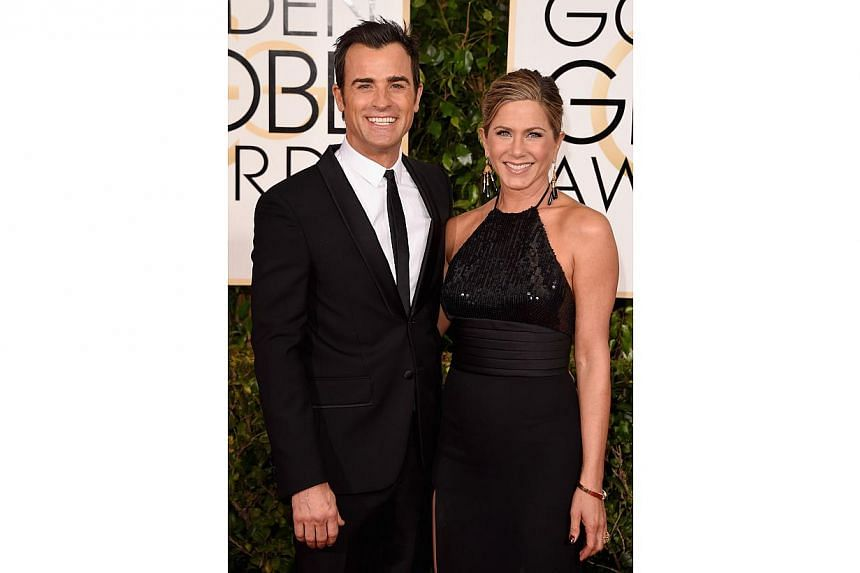 Actors Justin Theroux and Jennifer Aniston at the 72nd Annual Golden Globe Awards on Jan 11, 2015, in Beverly Hills, California. -- PHOTO: AFP