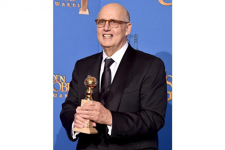 Jeffrey Tambor, winning a best actor award for his role in TV series Transparent, during the 72nd Annual Golden Globe Awards on Jan 11, 2015. -- PHOTO: AFP