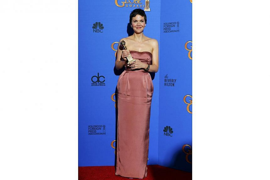 Actress Maggie Gyllenhaal posing backstage with her award for Best Performance by an Actress in a Mini-Series or Motion Picture made for Television for The Honorable Woman during the 72nd Golden Globe Awards on Jan 11, 2015. -- PHOTO: REUTERS