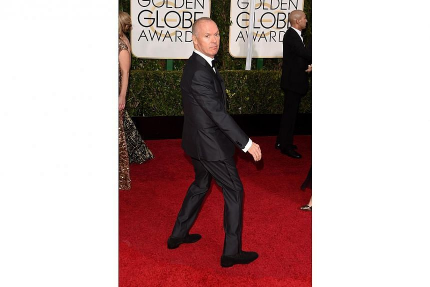 Michael Keaton wins best actor in a comedy or musical for Birdman at the Golden Globes on Sunday. -- PHOTO: AFP