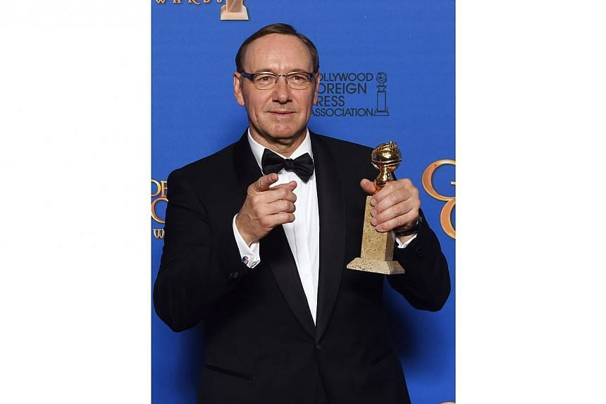 Kevin Spacey posing with the award for Best Actor - TV Series, Drama for his role in House Of Cards at the 72nd annual Golden Globe Awards. -- PHOTO: AFP