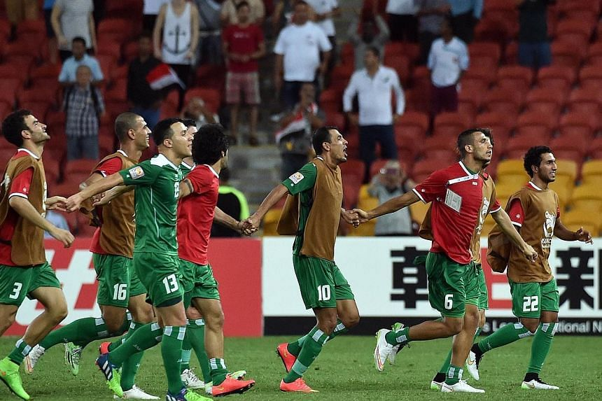 Iraqi players celebrate their victory over Jordan in the first round Asian Cup football match between Jordan and Iraq at the Suncorp Stadium in Brisbane on Jan 12, 2015.A magical goal from midfielder Yaser Kasim gave Iraq a crucial 1-0 win over