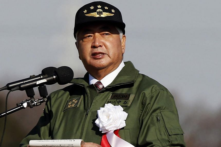 Japan's Defence Minister Gen Nakatani speaks during an annual new year military exercise by the Japanese Ground Self-Defense Force 1st Airborne Brigade at Narashino exercise field in Funabashi, east of Tokyo on Jan 11, 2015. -- PHOTO: REUTERS