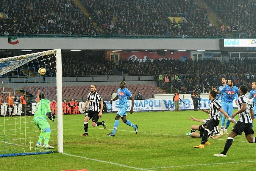 Juventus defender Martin Caceres of Uruguay scores to give his club a 2-1 goal lead against Napoli during the Italian Serie A match at San Paolo Stadium in Naples, Italy, on Jan 11, 2015. Juventus have hit out at the Serie A rivals who believe t