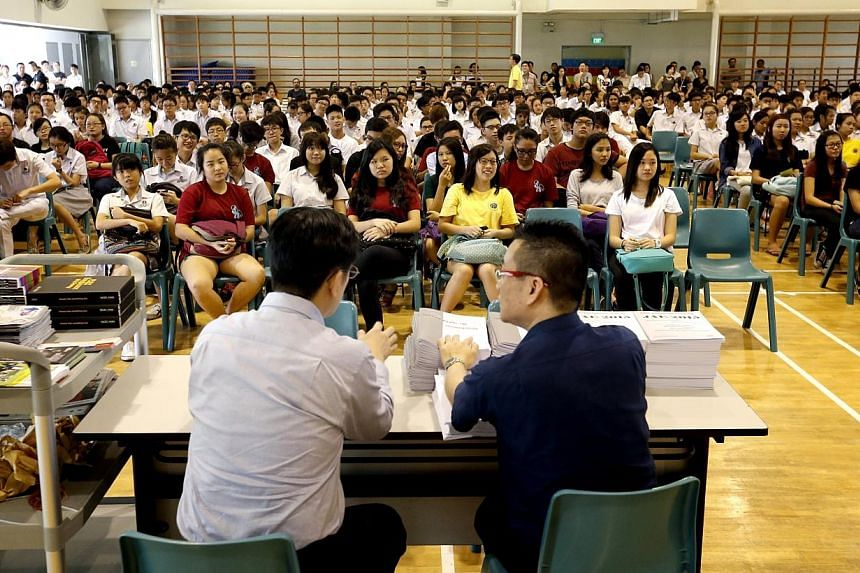 The first batch of Edgefield Secondary School students awaiting their GCE O-level examination results in the school hall on Jan 12, 2015. -- ST PHOTO: CHEW SENG KIM