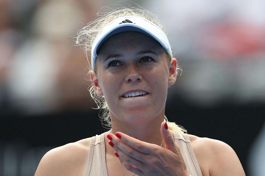 Caroline Wozniacki of Denmark retires hurt after injuring her wrist in her match with Barbora Zahlavova Strycova of Czech Republic during their women's singles match on day two of the Sydney International tennis tournament in Sydney on Jan 12, 2015.