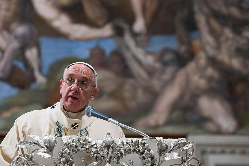 """Pope Francis delivering a speech during a baptizing ceremony in the Sistine Chapel at the Vatican on Jan 11, 2015.Pope Francis on Monday slammed """"deviant forms of religion"""" following deadly attacks by militants in France last week that left 17"""