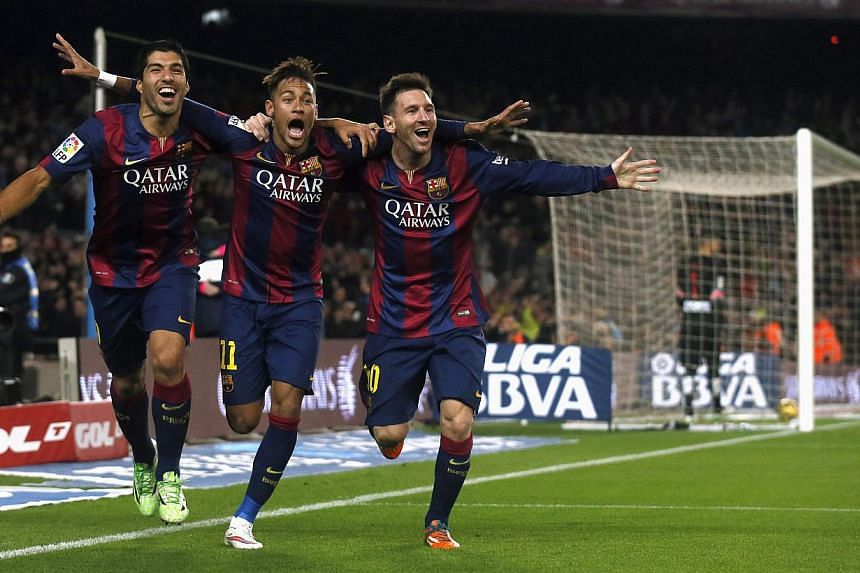 (From left) Barcelona's Luis Suarez, Neymar and Lionel Messi celebrate a goal against Atletico Madrid during their Spanish First Division football match at Camp Nou stadium in Barcelona on Jan 11, 2015.-- PHOTO: REUTERS