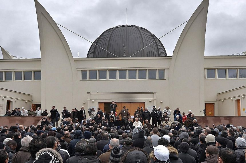 Hundreds of Muslims gathering outside the Grande Mosquee in Strasbourg, eastern France, to observe a minute of silence last Friday following the Charlie Hebdo attack which left 12 people dead. People holding up pens during a vigil in Lyon last Wednes