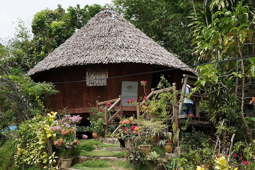 Efforts at Bung Jagoi to preserve the cultural heritage of the Jagoi-Bratak tribes include restoring the village baruk or ceremonial house (above) and reviving traditional ceremonies. -- ST PHOTO: CAROLYN HONG