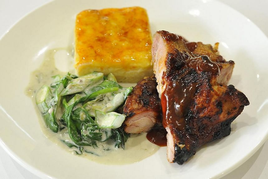The jerk chicken (above) by Lime House's chef Hasan Defour is marinated overnight so that it is flavourful. -- PHOTO: DIOS VINCOY JR FOR THE STRAITS TIMES