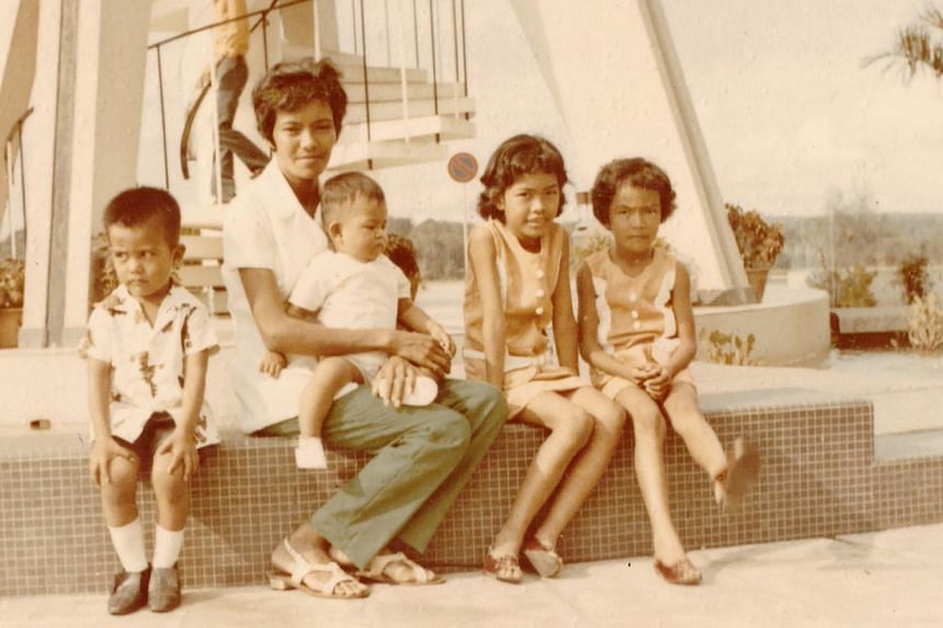 Mr Tom Ng, aged two, on his mother's lap, with his brother and two sisters at Seletar Reservoir. -- PHOTO: COURTESY OF TOM NG