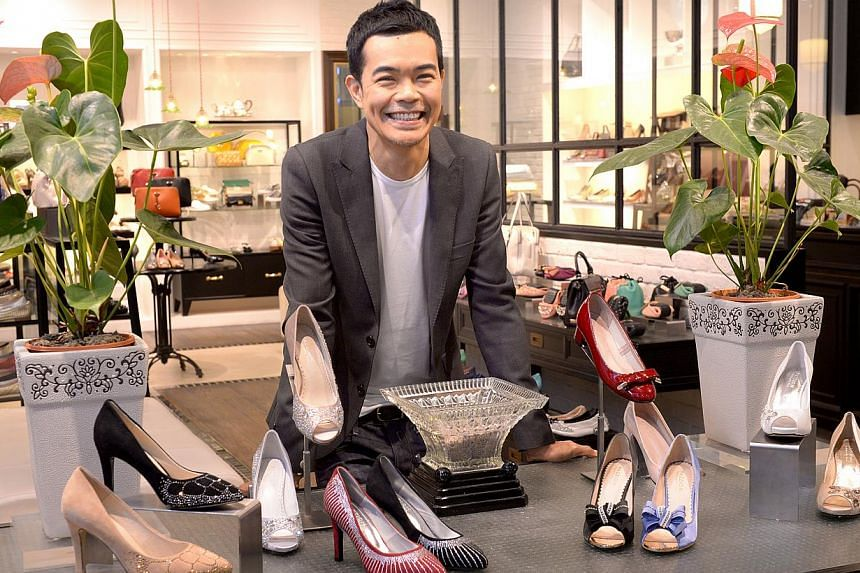 Fresh designs are a priority for Mr Tom Ng and he often flips through women's fashion magazines to see what is hot in the market. -- ST PHOTO: LIM SIN THAI