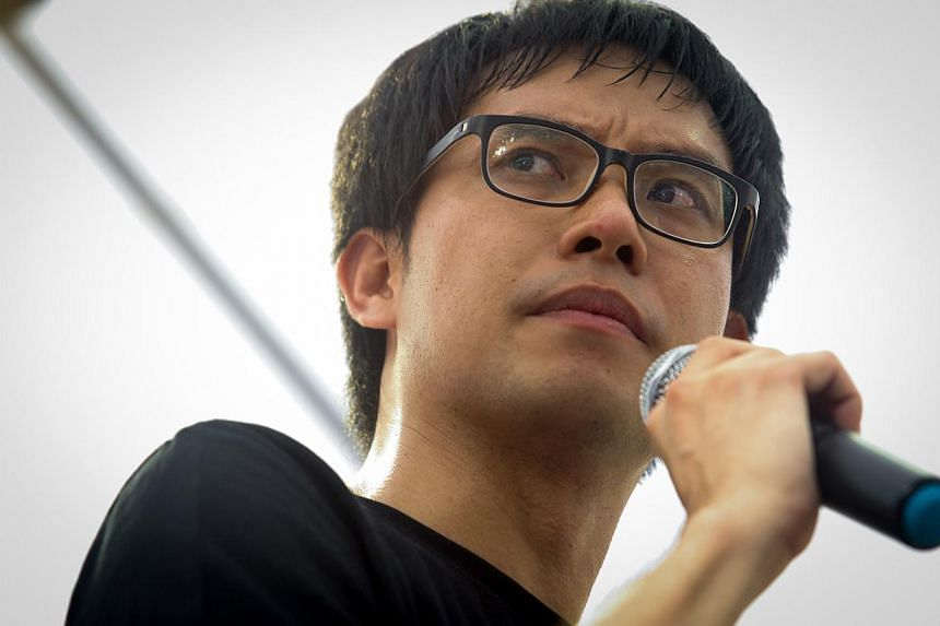 "Blogger Roy Ngerng at the ""Return Our CPF!"" protest in Hong Lim Park on June 7, 2014. He has been ordered by the High Court to pay Prime Minister Lee Hsien Loong $29,000 in costs for the defamation suit. -- PHOTO: ST FILE"