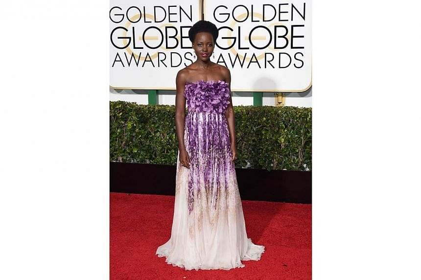 Actress Lupita Nyong'o on the red carpet for the 72nd annual Golden Globe Awards, on Jan 11, 2015. -- PHOTO: AFP
