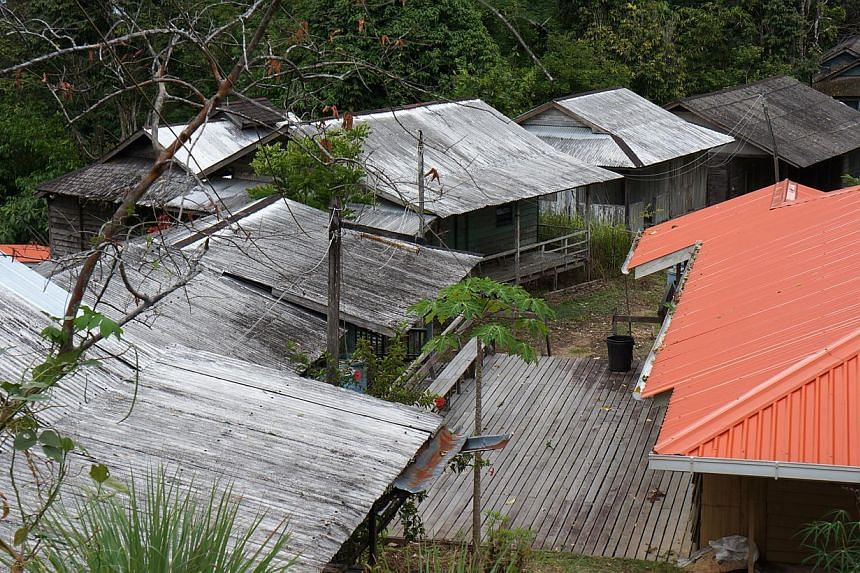 What's left of Bung Jagoi village is mostly abandoned houses.  -- ST PHOTO: CAROLYN HONG