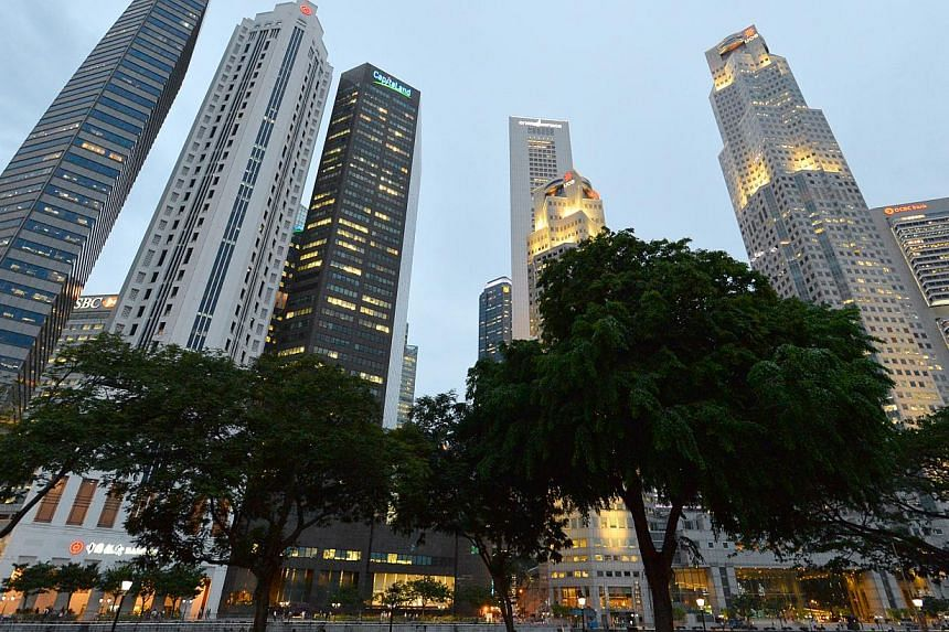 Singapore's CBD skyline. Amid mounting concerns of stronger global political headwinds and softer regional demand hitting exports, an index measuring confidence among Singapore businesses has tumbled at the start of the new year. -- ST PHOTO: LIM YAO