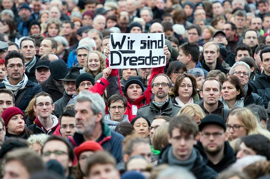 """Thousands of people of the so-called """"Patriotic Europeans Against the Islamisation of the Occident"""" (Pegida) participate in a rally in Dresden, Germany on Jan 10, 2015. Germany's growing anti-Islamic movement is set to hold a new rally on Monday, thi"""