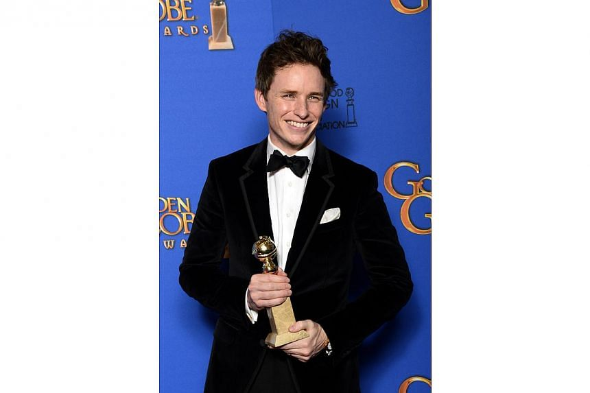 British actor Eddie Redmayne posing in the press room with his award for Best Performance by an Actor in a Motion Picture - Drama for The Theory Of Everything at the 72nd Annual Golden Globe Awards in Beverly Hills, California, Jan 11, 2015. -- PHOTO