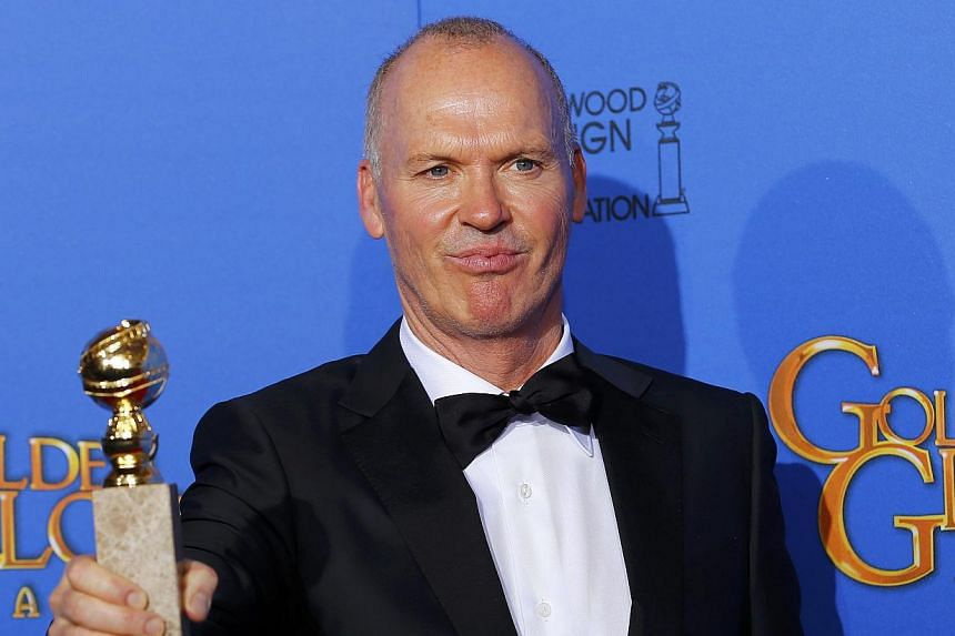 Michael Keaton posing backstage with his award for Best Actor in a Motion Picture - Musical or Comedy for his role in Birdman during the 72nd Golden Globe Awards in Beverly Hills, California on Jan 11, 2015. -- PHOTO: REUTERS