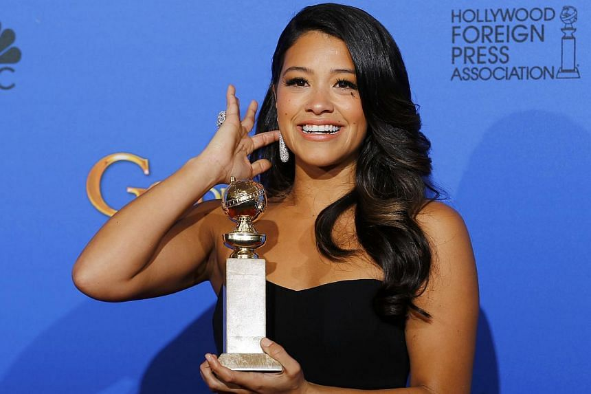 Gina Rodriguez posing with her award for Best Actress in a TV Series - Musical or Comedy for her role in Jane The Virgin backstage at the 72nd Golden Globe Awards in Beverly Hills, California, on Jan 11, 2015. -- PHOTO: REUTERS