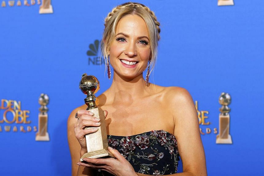 Joanne Froggatt posing with her award for Best Supporting Actress in a Series, Mini-Series or TV Movie for her role in Downton Abbey backstage at the 72nd Golden Globe Awards in Beverly Hills, California, on Jan 11, 2015. -- PHOTO: REUTERS