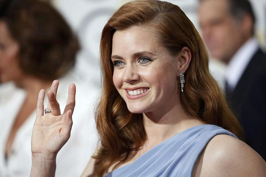 Amy Adams won the Golden Globe for best actress in a musical or comedy for her role in Tim Burton's based-on-true-life art fraud film Big Eyes. -- PHOTO: REUTERS